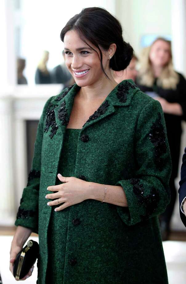 FILE - In this March 11, 2019 file photo, Britain's Meghan, Duchess of Sussex arrive for the Commonwealth Day Youth Event with Prince Harry, at Canada House in London. With another royal baby on the horizon, the debate over postpartum perfection is alive and well. As it stands, we don?t know whether Meghan Markle will follow in the footsteps of Kate Middleton when it comes to that magical perfection, but we have an inkling she?ll at least slap on some makeup when she introduces the latest royal to the world next month.  (Chris Jackson/Pool Photo via AP, File) Photo: Chris Jackson / 2019 Getty Images