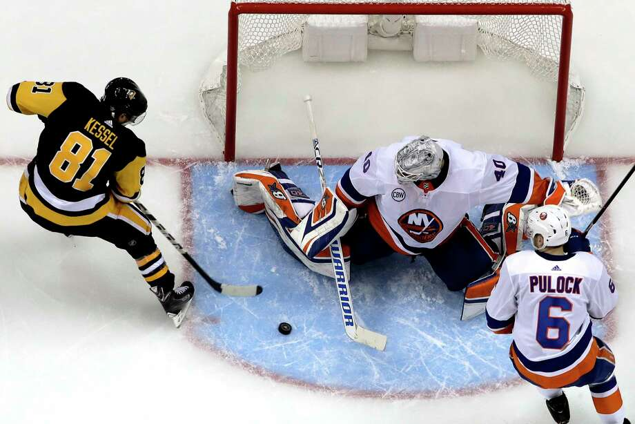 Pittsburgh Penguins' Phil Kessel (81) cannot get a shot past New York Islanders goaltender Robin Lehner (40) with Islanders' Ryan Pulock (6) also defending during the second period in Game 3 of an NHL first-round hockey playoff series in Pittsburgh, Sunday, April 14, 2019. (AP Photo/Gene J. Puskar) Photo: Gene J. Puskar / Copyright 2019 The Associated Press. All rights reserved