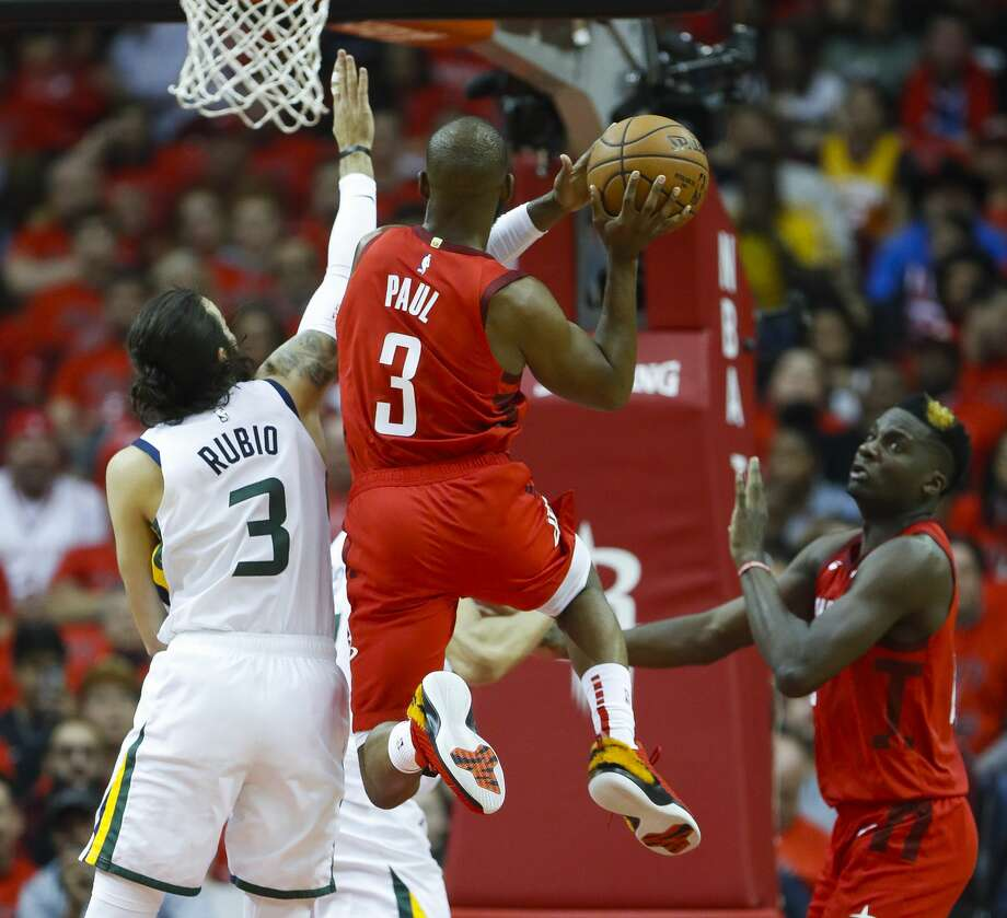 Houston Rockets guard Chris Paul (3) shoots past Utah Jazz guard Ricky Rubio (3) during the first half of the first round of the NBA playoffs at Toyota Center, Sunday, April 14, 2019, in Houston. Photo: Karen Warren/Staff Photographer