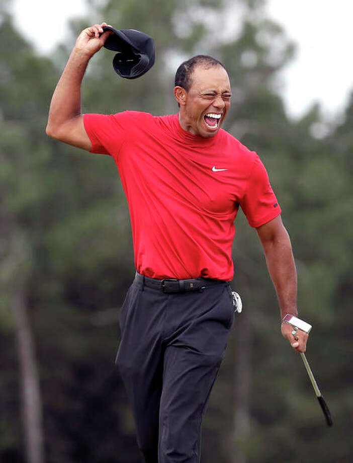 Tiger Woods reacts as he wins The Masters on Sunday in Augusta, Ga. Photo: Chris Carlson |AP Photo