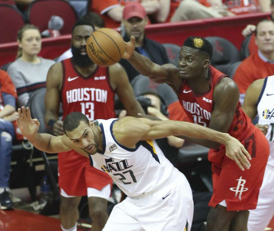 Houston Rockets center Clint Capela (15) knocks a ball out of play over Utah Jazz center Rudy Gobert (27) in the second half of the first game of an NBA playoff series at Toyota Center on Sunday, April 14, 2019 in Houston. Photo: Elizabeth Conley/Staff Photographer