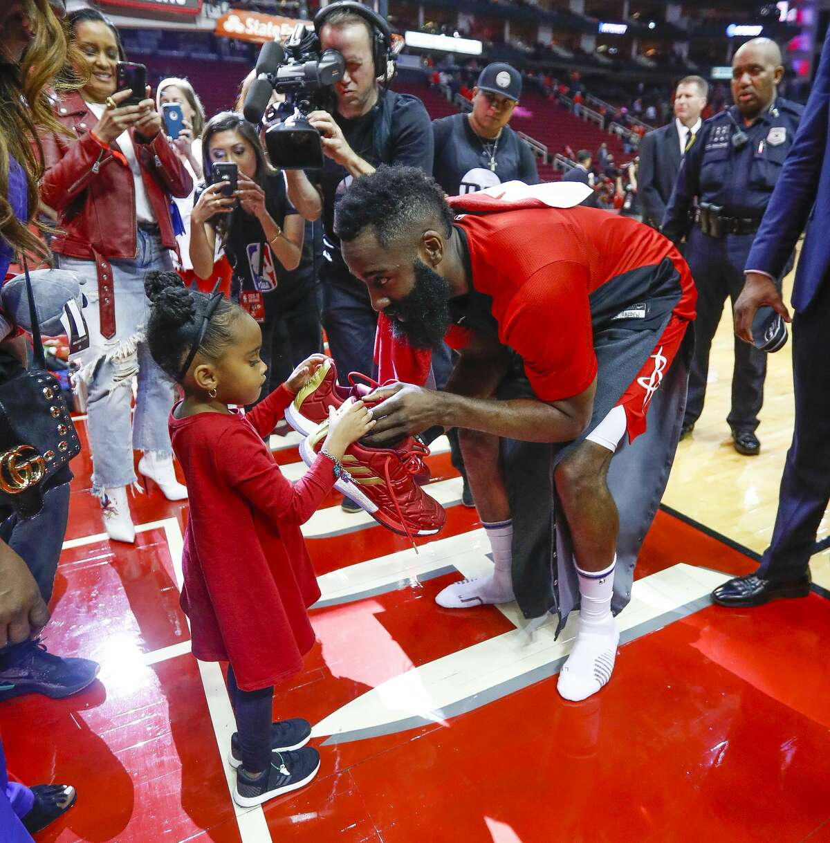 Houston Rockets guard James Harden (13) gives his shoes to Taylor James after the Rockets win over the Utah Jazz in the first game of the first round of the NBA playoffs at Toyota Center, Sunday, April 14, 2019, in Houston.