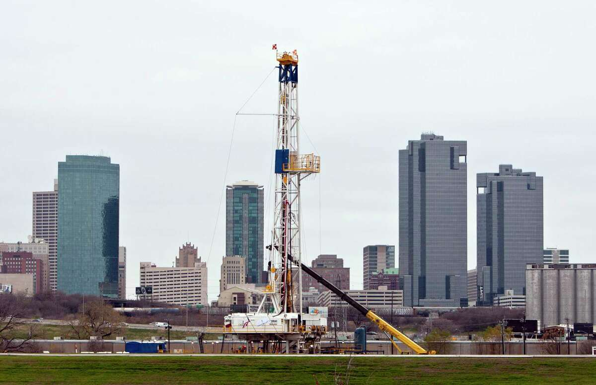 A gas drilling rig operates on the banks of the Trinity River just east of downtown Fort Worth, Texas in December 2011. French oil major Total has filed plans to drill 16 new horizontal wells spread across 10 leases in the Barnett Shale of North Texas.