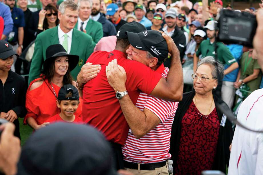 Tiger Woods hugs Glenn Greenspan, his publicist, after winning the Masters in Augusta, Ga., April 14, 2019. He captured his fifth Masters title and his 15th major tournament on Sunday, snapping a championship drought of nearly 11 years. (Doug Mills/The New York Times) Photo: DOUG MILLS / NYTNS