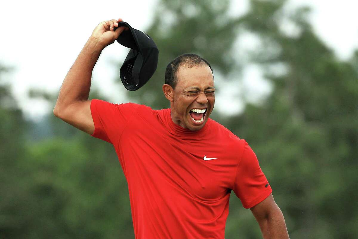 AUGUSTA, GEORGIA - APRIL 14: Tiger Woods of the United States celebrates after sinking his putt on the 18th green to win during the final round of the Masters at Augusta National Golf Club on April 14, 2019 in Augusta, Georgia. (Photo by Mike Ehrmann/Getty Images)