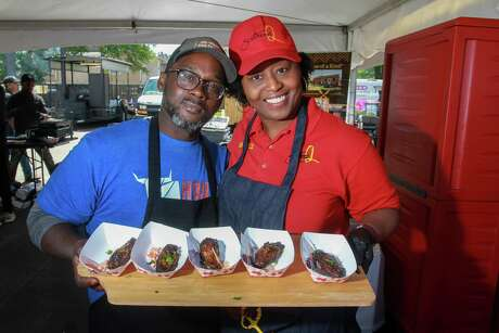 Steve and Sherice Garner holding Smoked Caribbean Jerk Wings from Southern Q at the 2019 Houston Barbecue Festival in Humble.