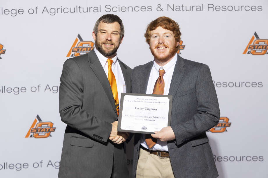 Tucker Cogburn (right) received a W.K. Kellogg Foundation and Bobby Moser Endowed Scholarship from Wyatt Hoback (left), assistant professor Oklahoma State University's College of Agricultural Sciences and Natural Resources. Photo: Provided By OSU