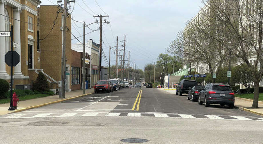 Second Street between St. Louis Avenue, foreground, and East High Street, four blocks distant, is one of many road projects the city's public works staff identified as in need of resurfacing, plus a new water main.