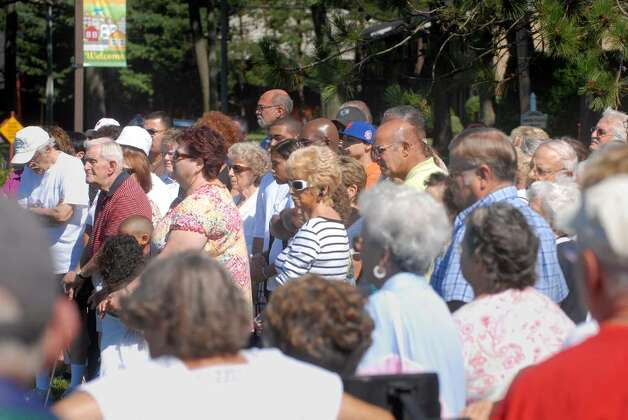 Residents of Shady Lane Apartments gather during a press conference Monday, July 26, 2010, across the street from Shady Lane Apartments in Glenville.  Employees and residents held the press conference to speak out against  a recent state Attorney General's lawsuit that claims the complex discriminated against certain groups of people wanting to live there.  (Paul Buckowski / Times Union) Photo: PAUL BUCKOWSKI / 00009623A