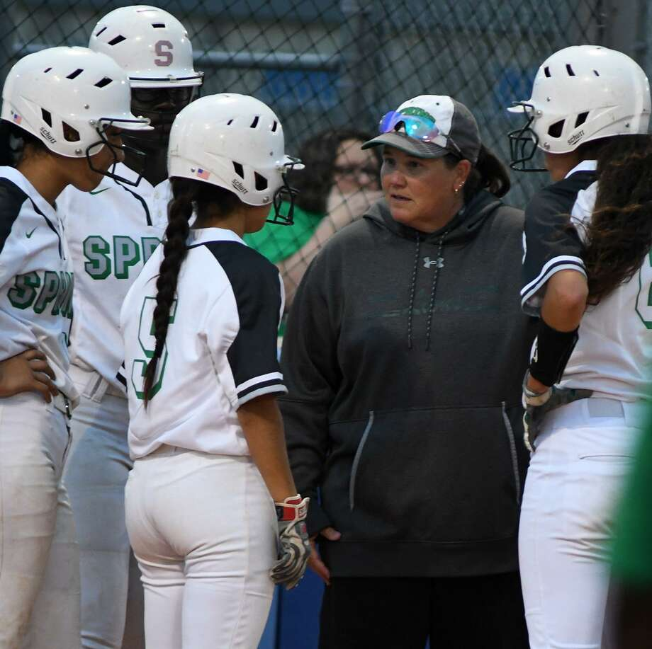 Spring Head Softball Coach Julie Wyrick, center, makes a point to junior Chloe Gomez (5) during a timeout against Dekaney in the top of the 4th inning of their District 16-6A matchup at Dekaney High School on Friday. Photo: Jerry Baker, Houston Chronicle / Contributor / Houston Chronicle