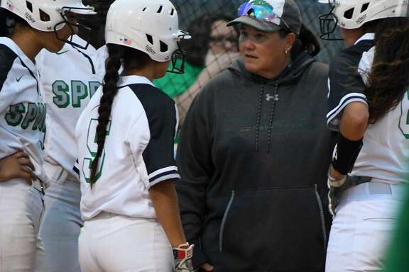 Spring Head Softball Coach Julie Wyrick, center, makes a point to junior Chloe Gomez (5) during a timeout against Dekaney in the top of the 4th inning of their District 16-6A matchup at Dekaney High School on Friday.