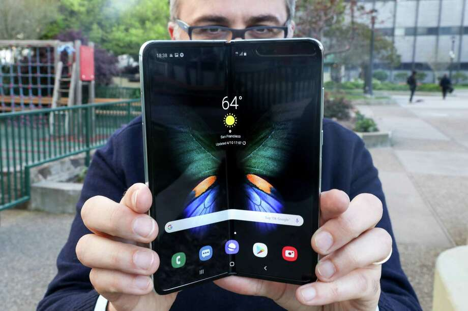 Opening Samsung's Galaxy Fold is a two-handed job, but closing it only takes one. Photo: Washington Post Photo By Jhaan Elker / The Washington Post