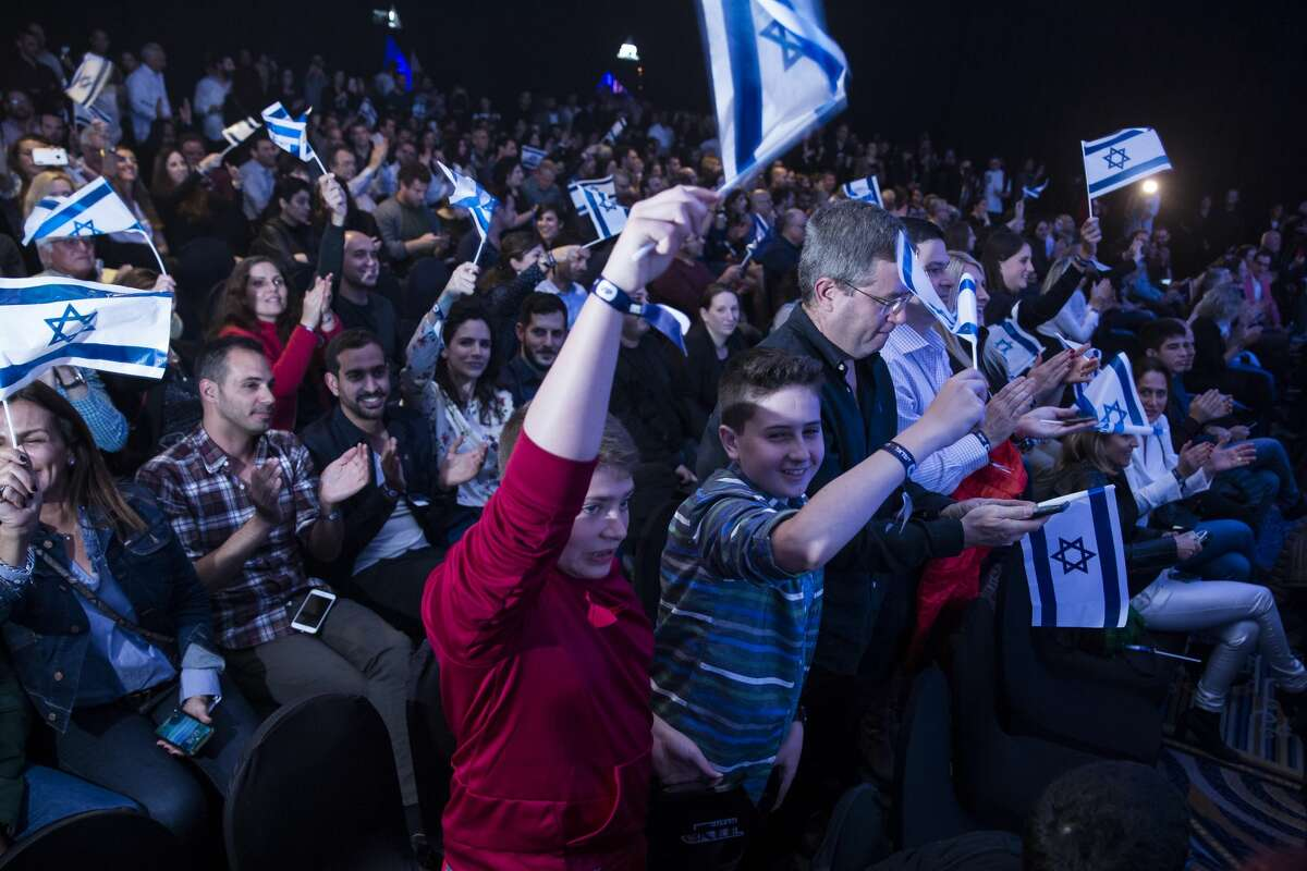 TEL AVIV, ISRAEL - APRIL 11: Israelis wave the Israeli flag after Beresheet spacecraft fails to land safely on the moon on April 11, 2019 in Tel Aviv, Israel. The Israeli spacecraft - called Beresheet, which is a joint project between SpaceIL, a privately funded Israeli non-profit organisation, and Israel Aerospace Industries failed to land on the lunar surface after the apparent failure of its main engine. (Photo by Amir Levy/Getty Images)