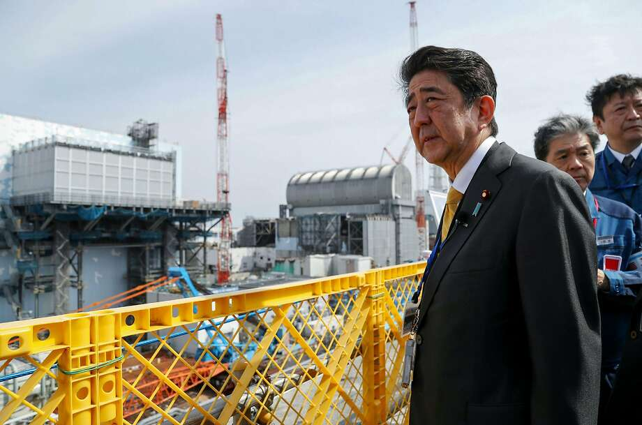 Japanese Prime Minister Shinzo Abe visits the Tokyo Electric Power Company's Fukushima nuclear plant Sunday, a day before technicians began removing fuel from a cooling pool. Photo: Jiji Press / AFP / Getty Images