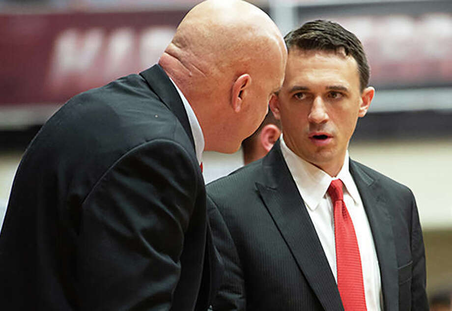 SIUE assistant coaches Brian Barone (right) and Mike Waldo talk during a break in a game last season at Vadalabene Center in Edwardsville. Barone, who spent the past two seasons as a Cougars assistant, steps up as the new head coach at SIUE Photo: SIUE Athletics