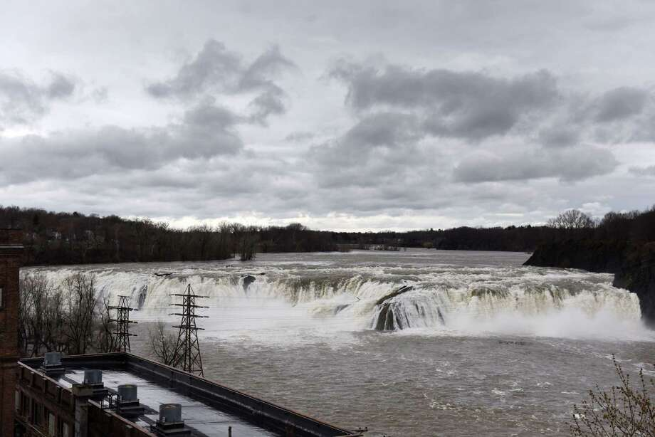 Water rushes over the Cohoes Falls following a heavy overnight rain on Monday, April 15, 2019, in Cohoes, N.Y.(Will Waldron/Times Union) Photo: Will Waldron, Albany Times Union