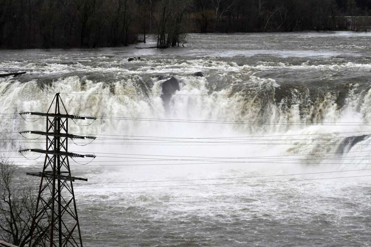 Water rushes over the Cohoes Falls following a heavy overnight rain on Monday, April 15, 2019, in Cohoes, N.Y.(Will Waldron/Times Union)