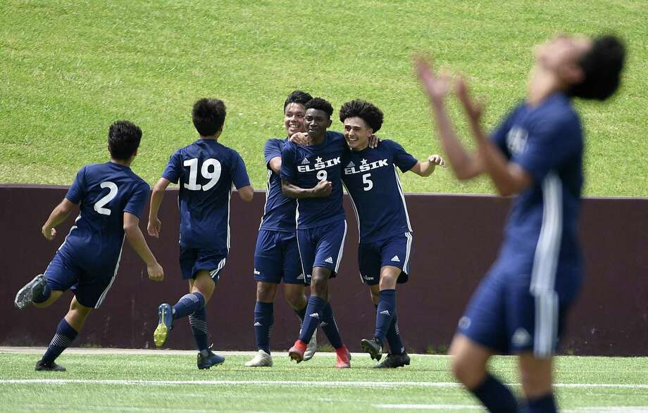 Elsik midfielder Dandord Ndabah (9) celebrates his goal with Andrei Aguirre (5) and teammates during the second half of a 6A region 3 final high school soccer match against Spring Woods, Saturday, April 13, 2019, in Deer Park. Photo: Eric Christian Smith, Contributor / Contributor