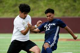 Elsik forward Mayno Linares, right, and Spring Woods midfielder Enoc Escalante fight fir possession during the first half of a 6A region 3 final high school soccer match, Saturday, April 13, 2019, in Deer Park.