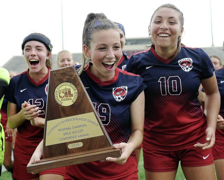 Tompkins' (left to right) Avery Burchett, Madison Walker, and Barbara Olivieri celebrate with the champion's trophy after their 3-2 victory over Kingwood in a 6A region 3 final high school soccer match, Saturday, April 13, 2019, in Deer Park. Photo: Eric Christian Smith, Contributor / Contributor