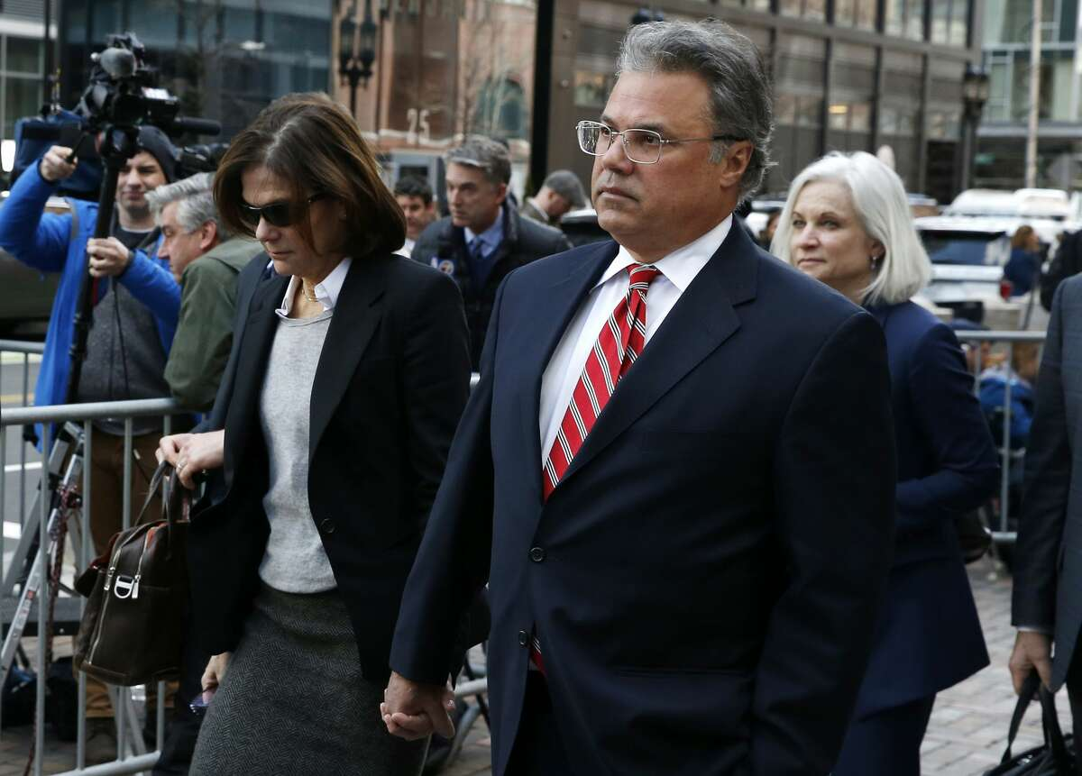 Manuel, right, and Elizabeth Henriquez leave the John Joseph Moakley United States Courthouse in Boston on April 3, 2019.