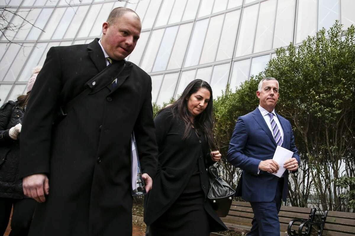 Marjorie Klapper of Menlo Park, center, leaves the John Joseph Moakley United States Courthouse in Boston on March 29, 2019.