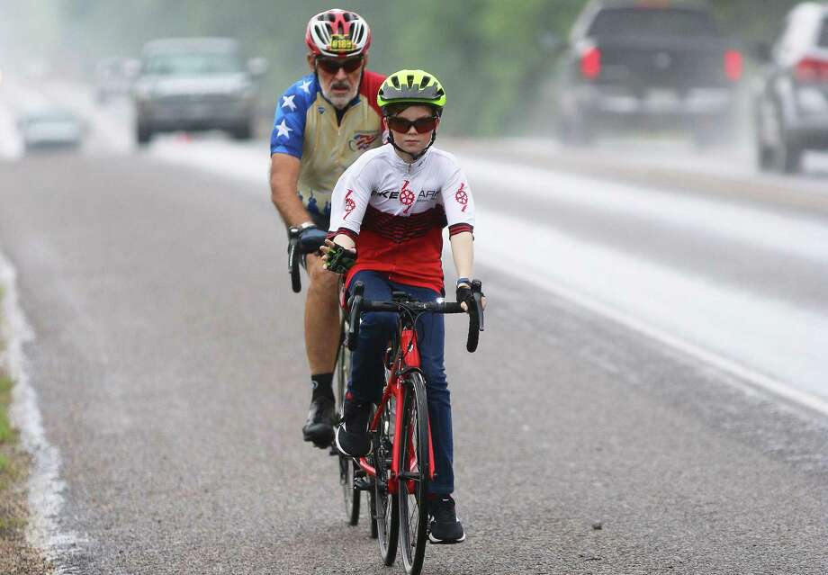 In his second year, Joshua Tully of Daisetta upped his game by doing the longer 30-mile ride. He found a friend, Rick Chandler of Humble, who partnered up with him and kept an eye on him throughout the ride. Photo: David Taylor / Staff Photo