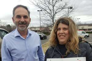 Rep. Dave Yaccarino, R-North Haven, with Cheryl Ann Cac, a Stop & Shop striker, Friday April 12, 2019 in North Haven