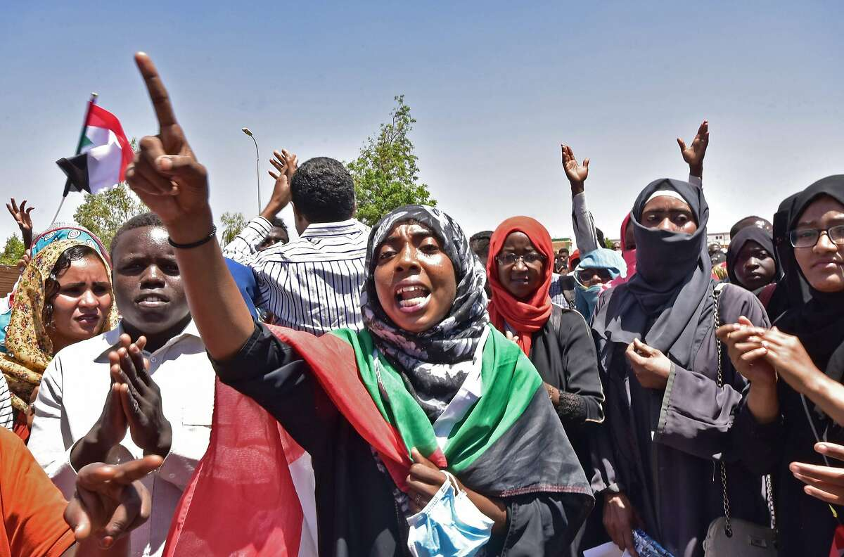 """Sudanese demonstrators gather near the military headquarters in the capital Khartoum on April 15, 2019. - Sudanese protest organisers called on their supporters to mobilise outside the army headquarters, saying there was an attempt to """"disperse the sit-in"""" where thousands have camped out for 10 days. (Photo by AHMED MUSTAFA / AFP)AHMED MUSTAFA/AFP/Getty Images"""