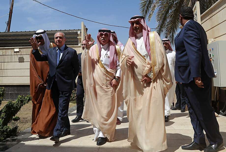 Iraqi Foreign Minister Mohamed Alhakim (second left) and Saudi Minister of Commerce Majid bin Abdullah Al Qasabi (center) attend the April 4 opening of the Saudi consulate in Baghdad. Photo: Hadi Mizban / Associated Press