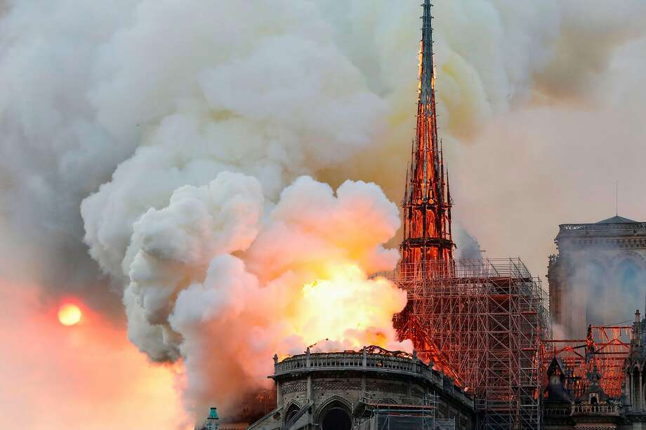 Smoke and flames shoot through the roof of Notre Dame Cathedral in Paris. As much as two-thirds of the roof was ravaged. Photo: Francois Guillot / AFP / Getty Images