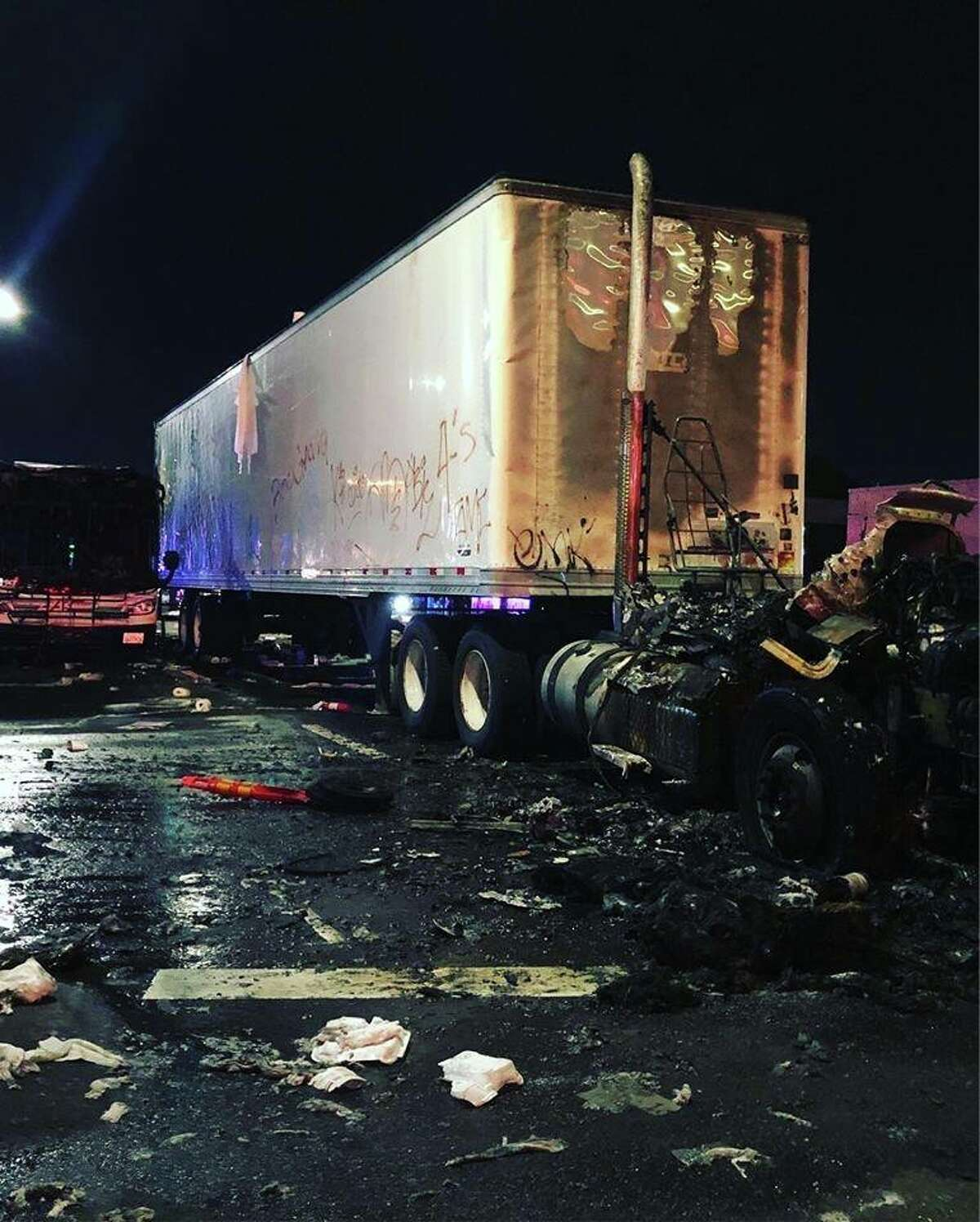 Photos of a sideshow in East Oakland on the night of April 14, 2019, show a big-rig truck and an AC Transit Bus damaged by fire.