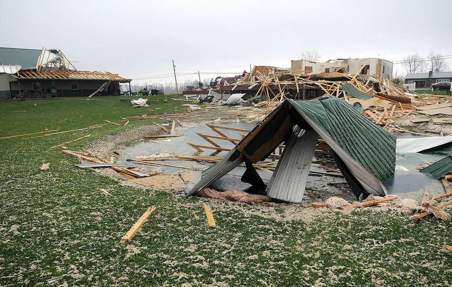Building debris litters a field Sunday in Shelby, Ohio, after a tornado ripped into the town, damaging homes and businesses. Photo: Tom E. Puskar / Ashland Times-Gazette