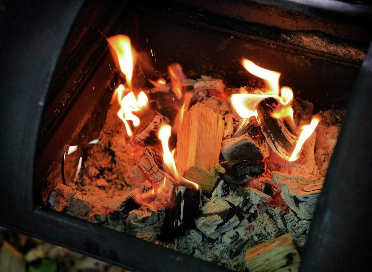 Chunks of fruitwood are added to the fire at a Texas-style barbecue party with smoked brisket, ribs and sausage. Low and slow is not the only way to barbecue.