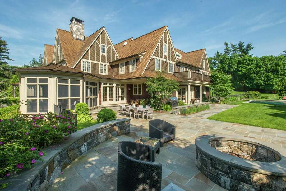 The screened-in porch is one of many intriguing attributes of 16 Doubling Road in Greenwich, a seven-bedroom, 11-bath shingle-style New England colonial on 2.93 acres. The property is listed by David Ogilvy & Associates for $9.7 million. Photo: David Ogilvy & Associates / © SR Photo, LLC All Rights Reserved