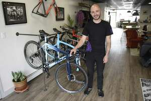 Owner Justin Bagnati stands inside Black Oak Velo cycling store at 188 Sound Beach Ave., in Greenwich, Conn., on Thursday, April 11, 2019. The shop, which opened in January, sells high-end bikes, custom-fit bikes, bicycle accessories, as well as beer on tap.