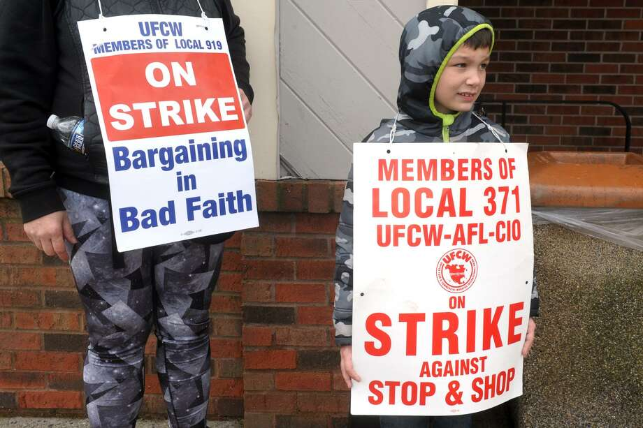 Liam Phillips stands on the picket line with his great-aunt, Sandy Hoffman, in front of the Stop & Shop on Bridgeport Avenue in Shelton, Conn. April 15, 2019. Monday marked the fifth day of strike. Photo: Ned Gerard / Hearst Connecticut Media / Connecticut Post
