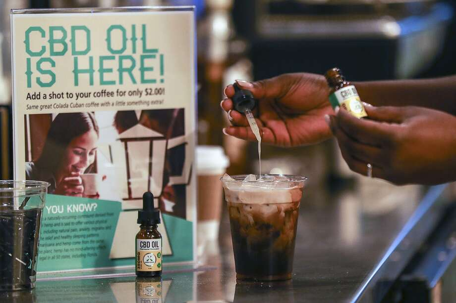 FILE - In this Jan. 4, 2018, file photo, a worker adds cannabidiol (CBD) to a drink at a coffee shop in Fort Lauderdale, Fla. Mainstream retailers are leaping into the world of products like skin creams and oils that tout such benefits as reducing anxiety and helping you sleep. The key ingredient is CBD, or cannabidiol, a compound derived from hemp and marijuana that doesn't cause a high. (Jennifer Lett/South Florida Sun-Sentinel via AP, File) Photo: Jennifer Lett, Associated Press