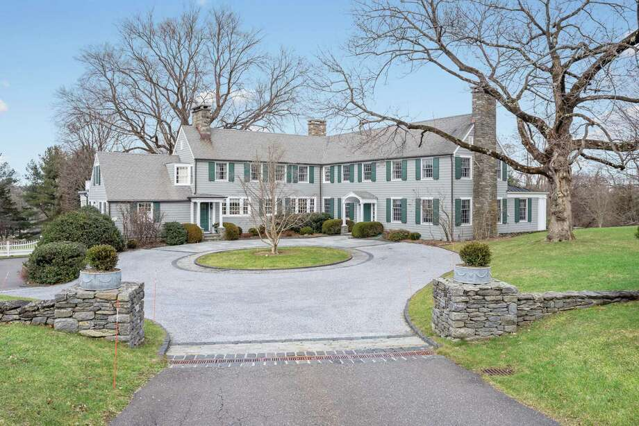 Listed by William Raveis Real Estate for $2.765 million, 42 Drum Hill Road in Wilton is centrally and conveniently located, with a six-bedroom colonial and three-car garage on 3.86 acres. Photo: William Raveis Real Estate / ONLINE_CHECK