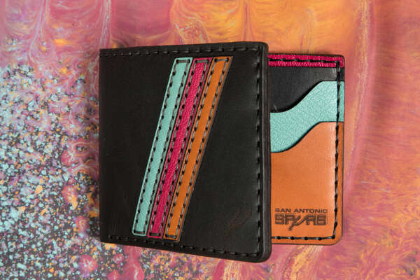 Spurs fans have new merchandise to snag: a limited line of wallets, key chains and other leather goods crafted by Bexar Goods Co. in collaboration with the team. The nine-piece collection is all made locally and features the Spurs brand with the team's throwback colors as well as buck brown and black.