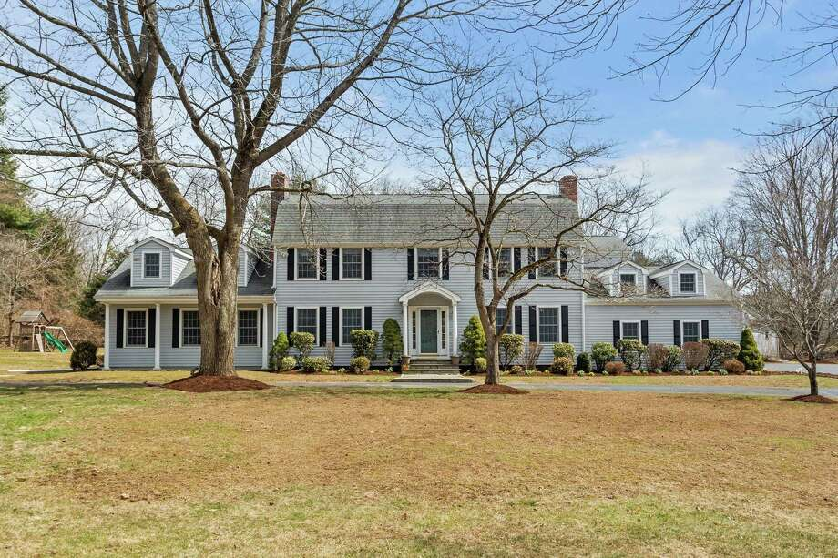 The time is right to move into the gray colonial house at 200 Eleven O'Clock Road in Greenfield Hill.
