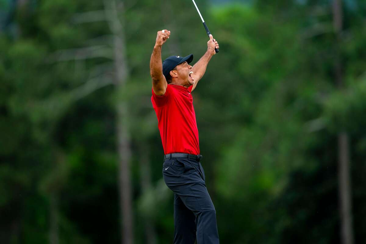 Tiger Woods reacts on the 18th hole after winning the Masters in Augusta, Ga., April 14, 2019. He captured his fifth Masters title and his 15th major tournament on Sunday, snapping a championship drought of nearly 11 years. (Doug Mills/The New York Times)