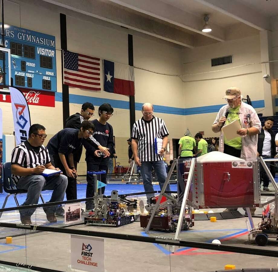 Ironclad drivers Vedant and Ben work with field coach Moneer in the middle of a match at the Southeast Texas First Tech Challenge Championship. The Katy Ironclad team advanced after its performance. Photo: Courtesy Harmony School Of Innovation-Katy / Courtesy Harmony School Of Innovation-Katy