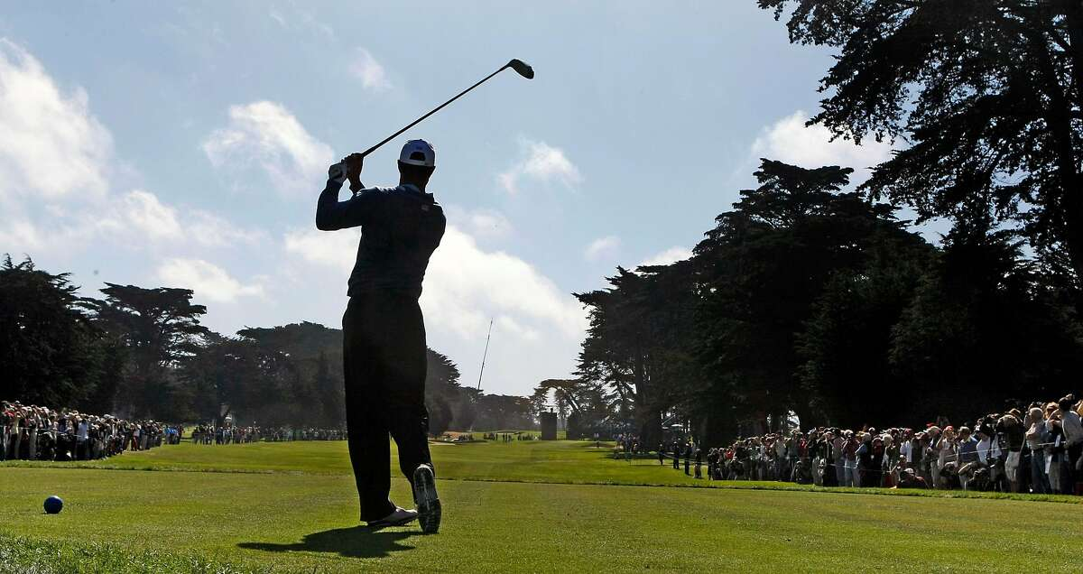 Tiger Woods tees off on the 17th hole at Harding Park in San Francisco as the third day of the President's Cup practice round are concluded.