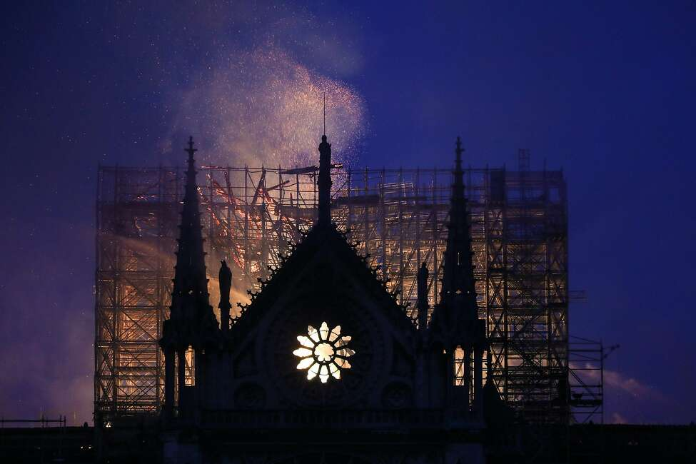 Smoke and flames rise during a fire at the landmark Notre-Dame Cathedral in central Paris on April 15, 2019, potentially involving renovation works being carried out at the site, the fire service said. - A major fire broke out at the landmark Notre-Dame Cathedral in central Paris sending flames and huge clouds of grey smoke billowing into the sky, the fire service said. The flames and smoke plumed from the spire and roof of the gothic cathedral, visited by millions of people a year, where renovations are currently underway. (Photo by LUDOVIC MARIN / AFP)LUDOVIC MARIN/AFP/Getty Images