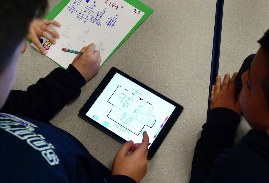 A student in a Norwalk school uses an iPad to create a design for a renovation project. Photo: Erik Trautmann / Hearst Connecticut Media / Norwalk Hour