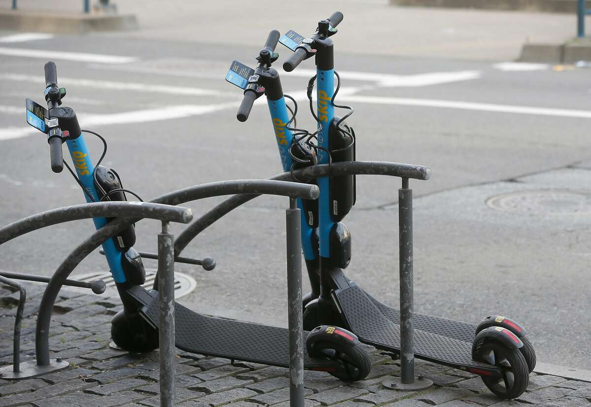 Skip e-scooters are parked on King Street in San Francisco, Calif. on Tuesday, March 19, 2019.