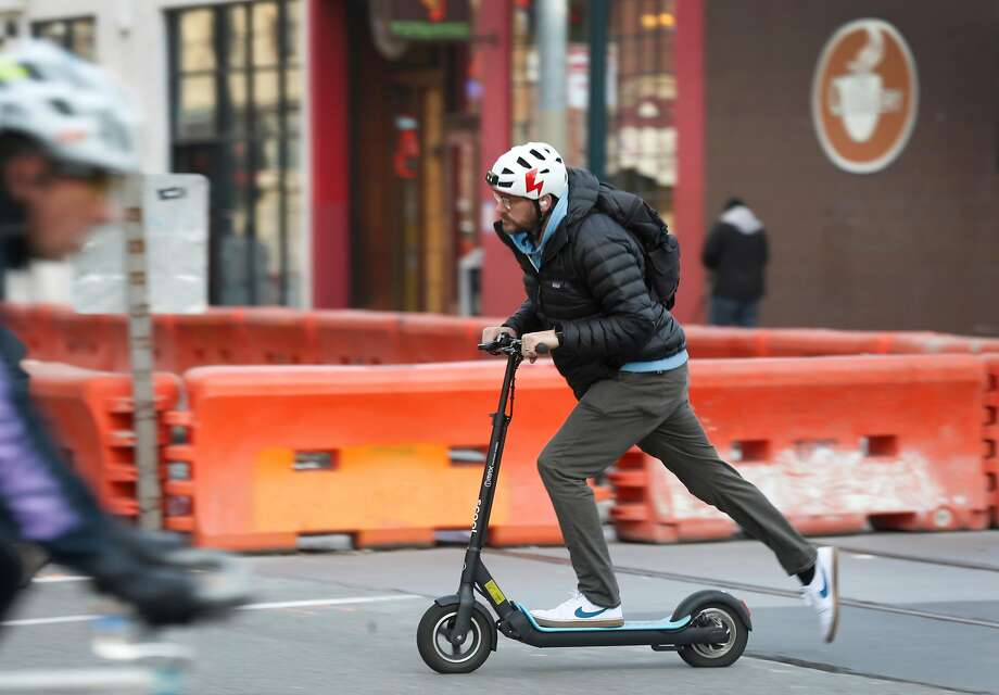 E-scooters are taking off in cities around the country -- except for Seattle, where they remain illegal. Photo: Paul Chinn / The Chronicle