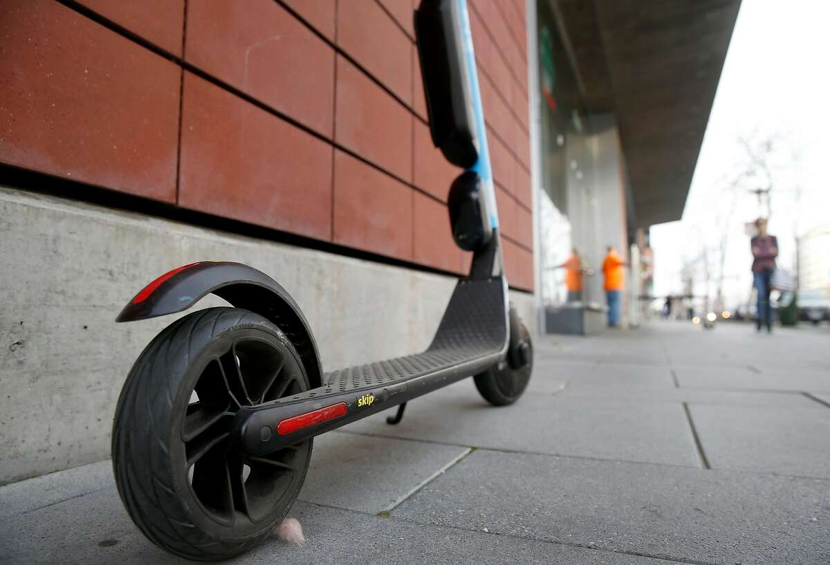 A Skip e-scooter is parked on King Street in San Francisco, Calif. on Tuesday, March 19, 2019.
