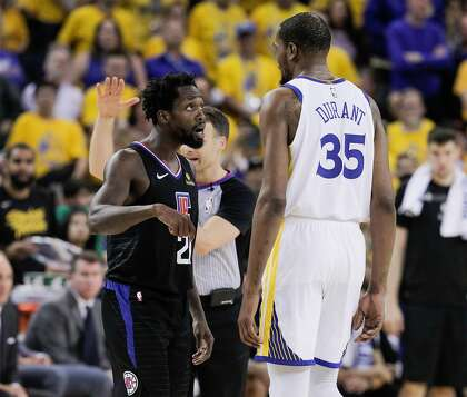 fc1bfec4a207 Los Angeles Clippers Patrick Beverley and Golden State Warriors Kevin Durant  share words in the fourth quarter during game 1 of the Western Conference  ...